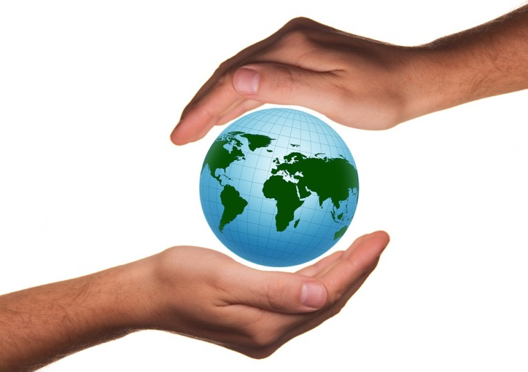 Handful Of Globe Protect Hand Protection Earth